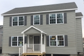 A Photo Of 283 Stock Model Modular Home Tan Exterior With Two Stories