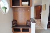 Photo Of Double Wide Home 5225-508 Foyer With Wood Bench And Hangers
