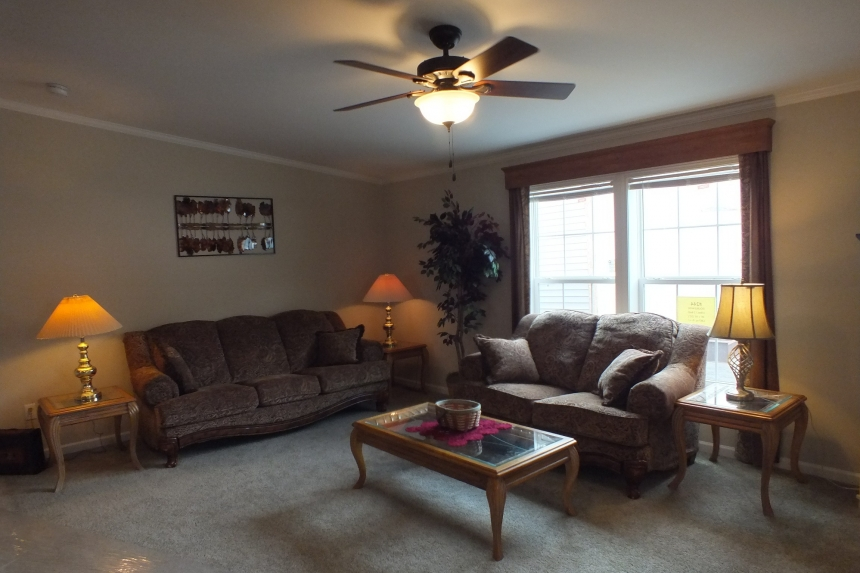 Photo Of Double Wide Home 5225-508 Furnished Living Room With Bright Windows And Ceiling Fan