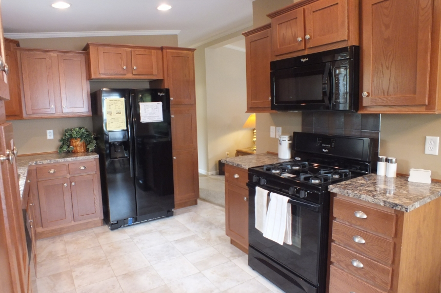Photo Of Double Wide Home 5225-508 Kitchen With Wood Cabinets And Black Refrigerator