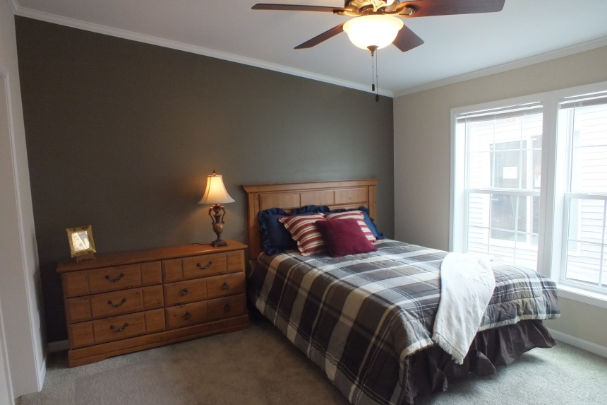 Photo Of Double Wide Home 5225-508 Furnished Bedroom With Large Windows And Ceiling Fan