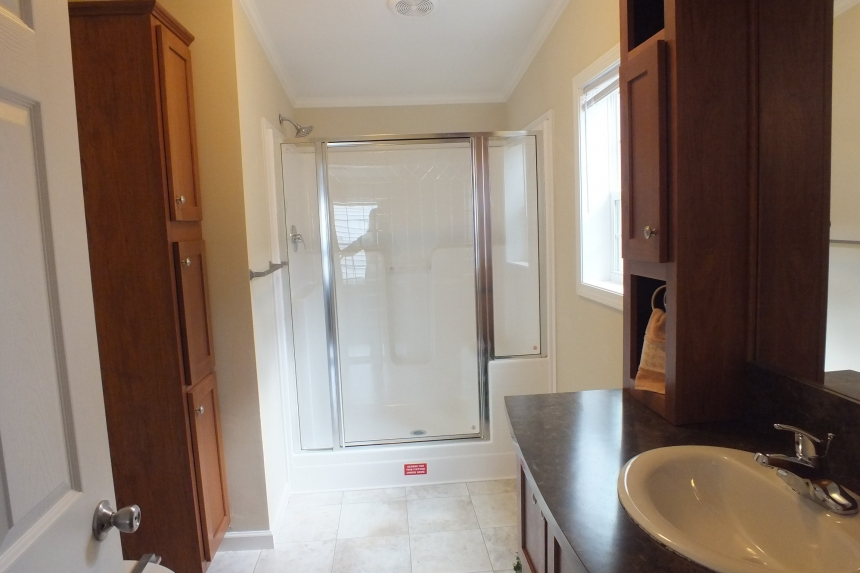 Photo Of Double Wide Home 5225-508 Bathroom With Wood Cabinets And Shower