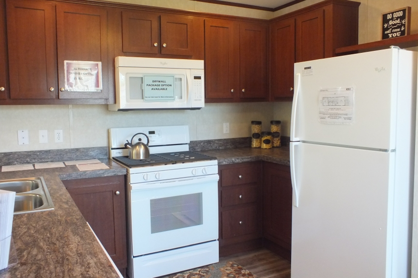 Photo Of Single-Wide Home F-44831 Kitchen With White Stove And Refrigerator