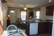 Photo Of Single-Wide Home F-44831 Furnished Dining Area Looking Into Kitchen