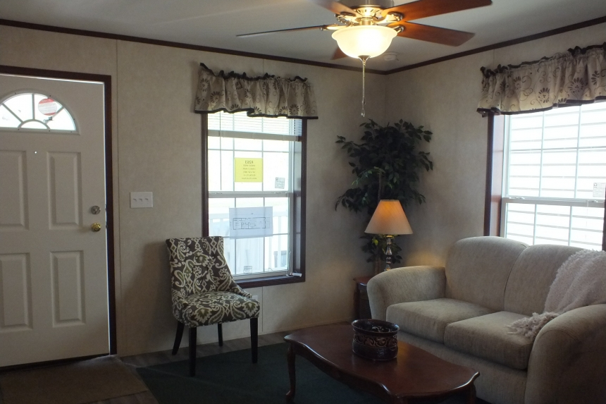 Photo Of Single-Wide Home F-44831 Furnished Living Area With Two Large Bright Windows