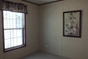 Photo Of Single-Wide Home F-44831 Bedroom With Bright Window And Painting Of Flowers