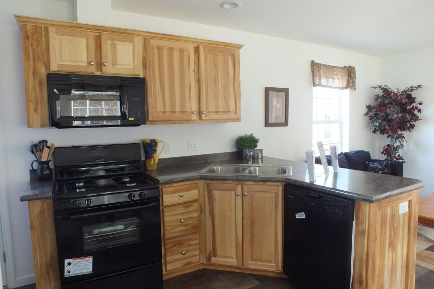Photo Of Single Wide Home A12001P Kitchen With Black Appliances And Wood Cabinets