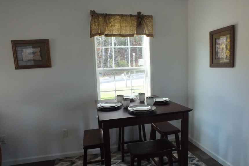 Photo Of Single Wide Home A12001P Dining Area With Small Table And Bright Window