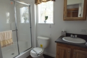 Photo Of Single Wide Home A12001P Bathrom With Toilet Walk In Shower And Bright Window