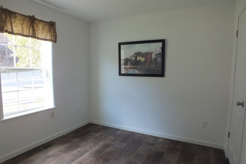 Photo Of Single Wide Home A12001P Unfurnished Bedroom With Brigh Window And Painting Hanging On Wall