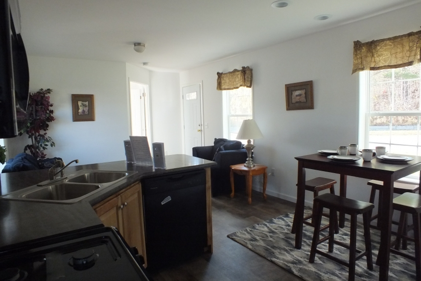 Photo Of Single Wide Home A12001P Furnished Dining Area And Kitchen Looking Into Living Area