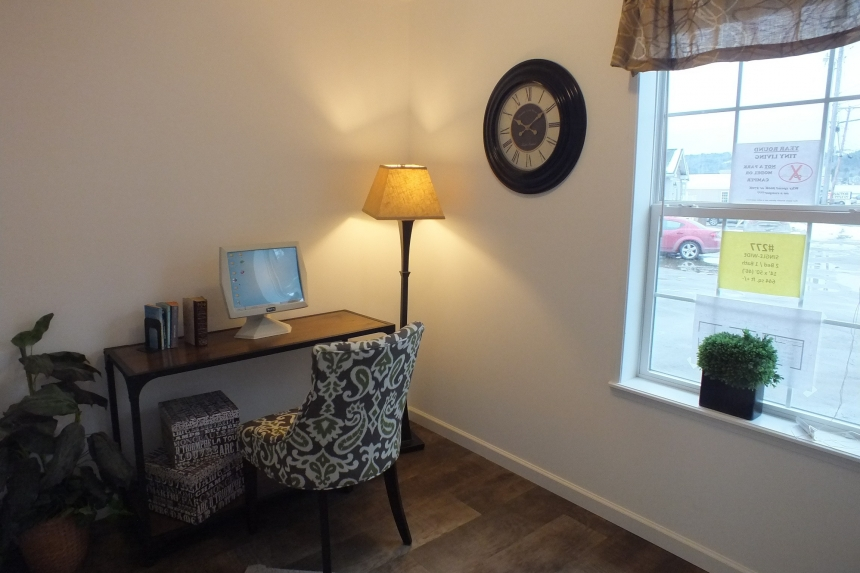 Photo Of Single Wide Home A12001P Furnished Bedroom With Desk And Large Wndow