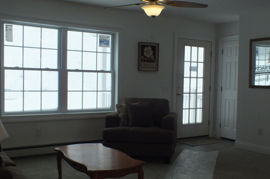 A Photo Of 283 Stock Model Modular Home Living Room And Front Door.