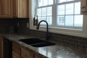 A Photo Of 283 Stock Model Modular Home Kitchen Sink And Windows.