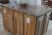 A Photo Of 283 Stock Model Modular Home Kitchen Island With Wooden Cabinets