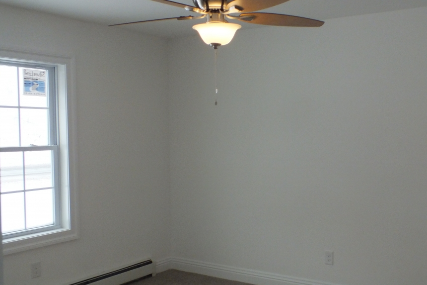 A Photo Of 283 Stock Model Modular Home Unfurnished Bedroom With A Ceiling Fan.