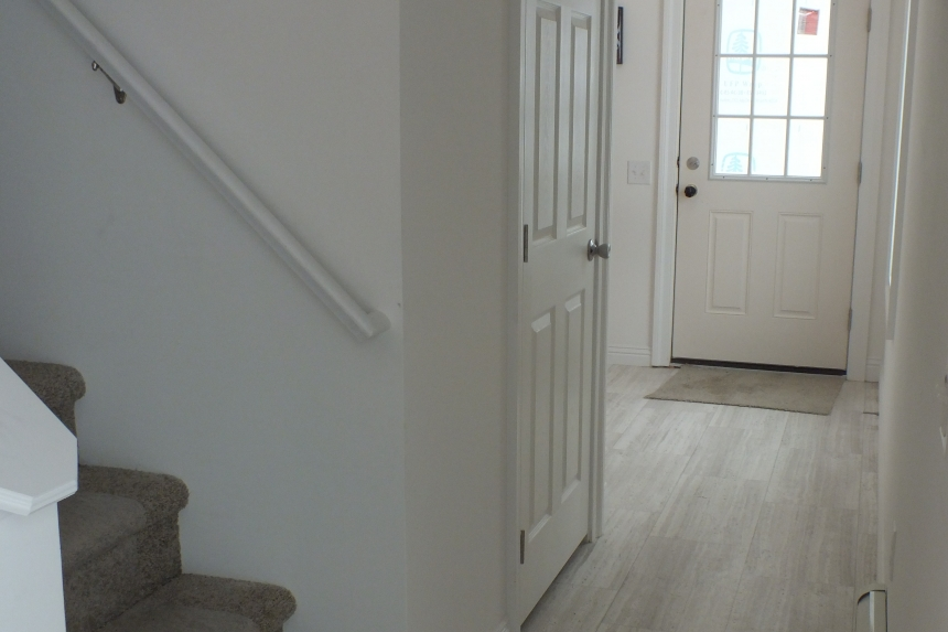 A Photo Of 283 Stock Model Modular Home Entryway And Stairs.