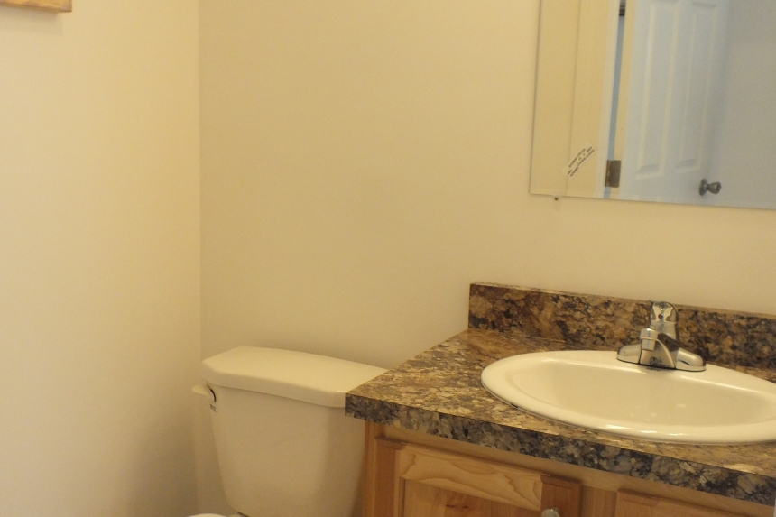 A Photo Of 283 Stock Model Modular Home Bathroom Sink And Toilet.