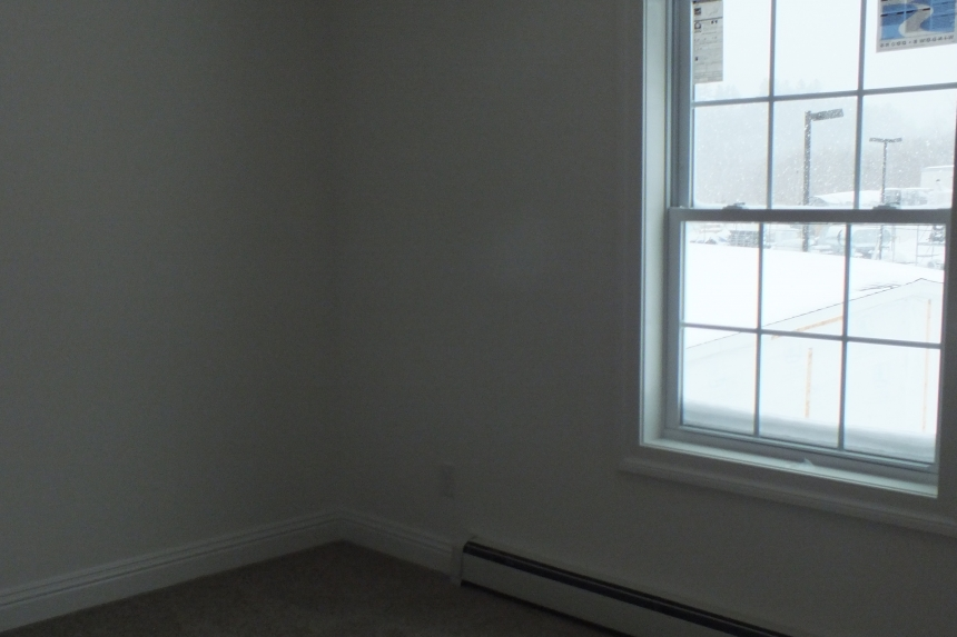 A Photo Of 283 Stock Model Modular Home Unfurnished Bedroom With Large Window.