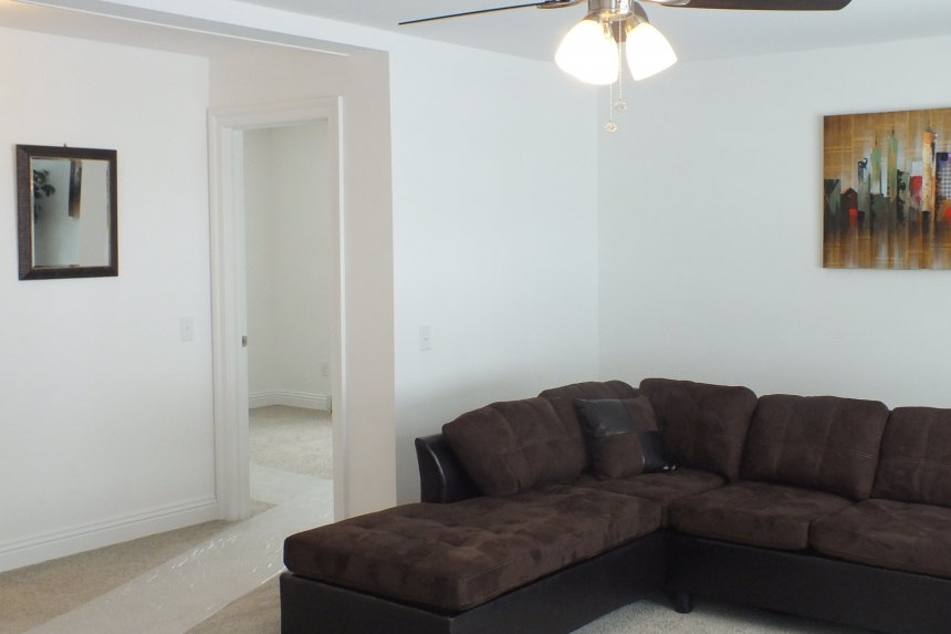 A Photo Of 283 Stock Model Modular Home Living Area With Brown Couch.