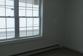 A Photo Of 283 Stock Model Modular Home Room With Large Windows Looking Out Into A Snow Bank.