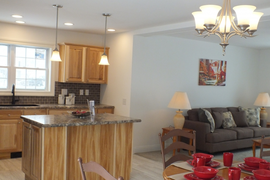 A Photo Of 283 Stock Model Modular Home Of Light Filled Living Area And Kitchen