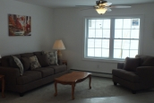 A Photo Of 283 Stock Model Modular Home Furnished Living Room.