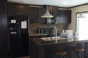 Photo Of Double Wide Home 302 Stock Model Kitchen With Wood Cabinets And Bright Glass Door