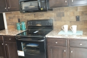 Photo Of Double Wide Home 302 Stock Model Kitchen Range And Counter With Wood Cabinets