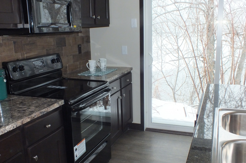 Photo Of Double Wide Home 302 Stock Model Black Range Looking Out Through Large Glass Door