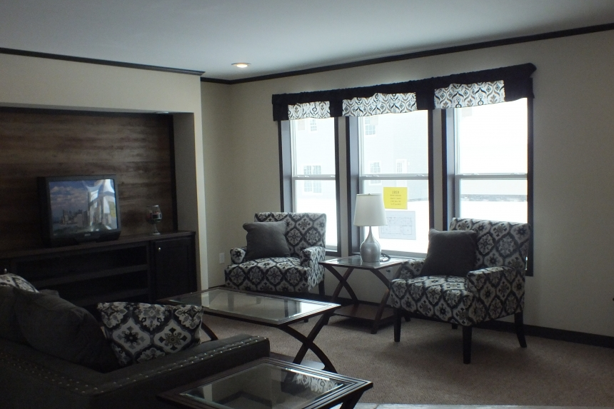 Photo Of Double Wide Home 302 Stock Model Furnished Living Area With Three Large Bright Windows
