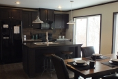 Photo Of Double Wide Home 302 Stock Model Furnished Dining Room Looking Into Kitchen