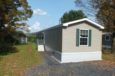 A photo of a tab single-wide manufactured home ready for move in.