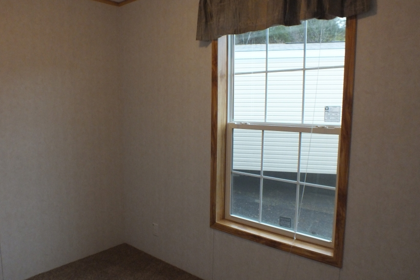 A Photo Of 98 Stock Model Single Wide Home Bedroom