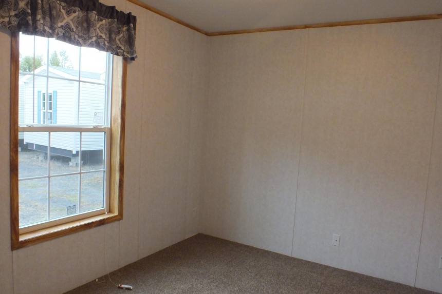 A Photo Of 98 Stock Model Single Wide Home Unfurnished Bedroom With Large Window