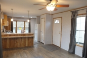 A Photo Of 98 Stock Model Single Wide Home Kitchen Seen From Living Room
