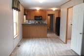 Photo Of Single Wide Home 294 Stock Model Empty Living Area Looking Into Kitchen