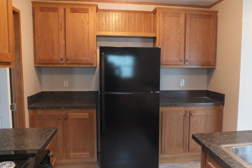 Photo Of Single Wide Home 294 Stock Model Black Refrigerator And Wood Cabinets