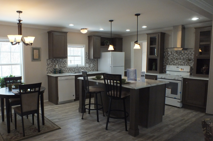 A Photo Of Stock Model 296 Double Wide Home Kitchen And Dining Area