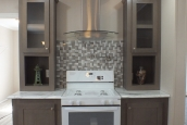 A Photo Of Stock Model 296 Double Wide Home White Stove And Cabinets