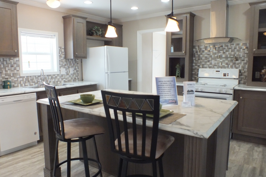 A Photo Of Stock Model 296 Double Wide Home Kitchen With Island And Appliances