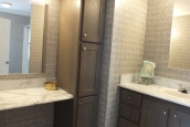 A Photo Of Stock Model 296 Double Wide Home Bathroom With Cabinets And Two Vanities