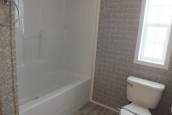 A Photo Of Stock Model 296 Double Wide Home Bathroom Tub And Toilet