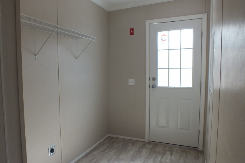 A Photo Of Stock Model 296 Double Wide Home Entry Way With Door To Exterior