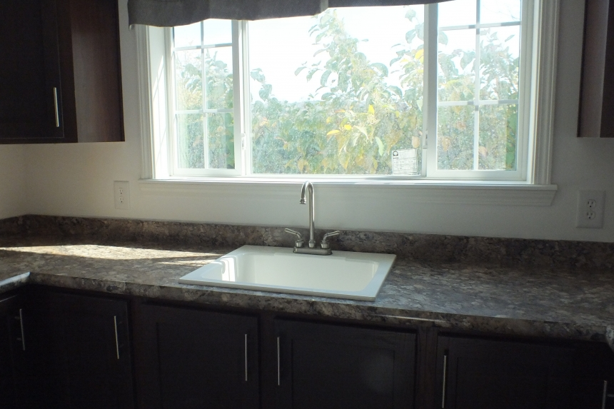 Photo Of Double Wide Home 303 Stock Model Kitchen With Bright Window Over Sink And Counters
