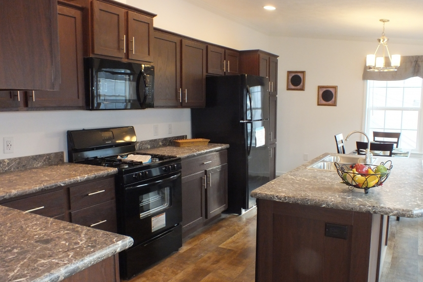 Photo Of Double Wide Home 303 Stock Model Kitchen With Black Appliances And Wood Cabinets