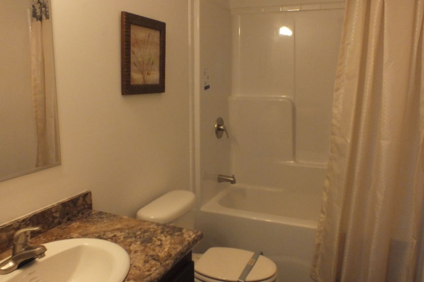 Photo Of Double Wide Home 303 Stock Model Bathroom With Toilet And Tub