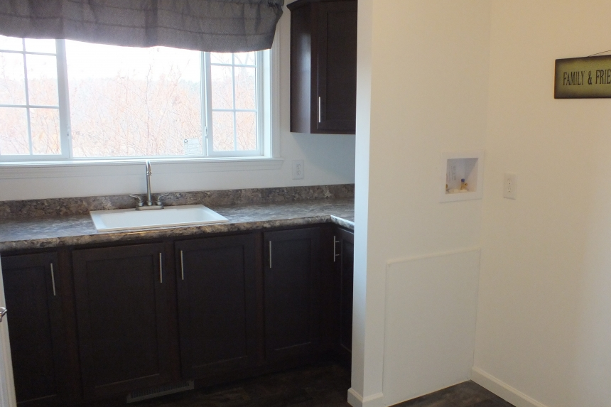 Photo Of Double Wide Home 303 Stock Model Bright Window Over Kitchen Sink And Wood Cabinets