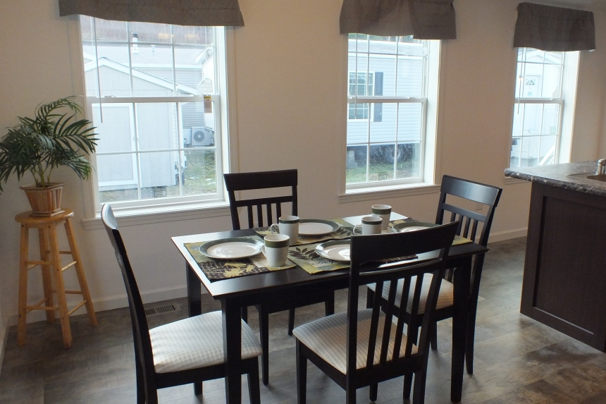 Photo Of Double Wide Home 303 Stock Model Furnished Dining Area With Small Table