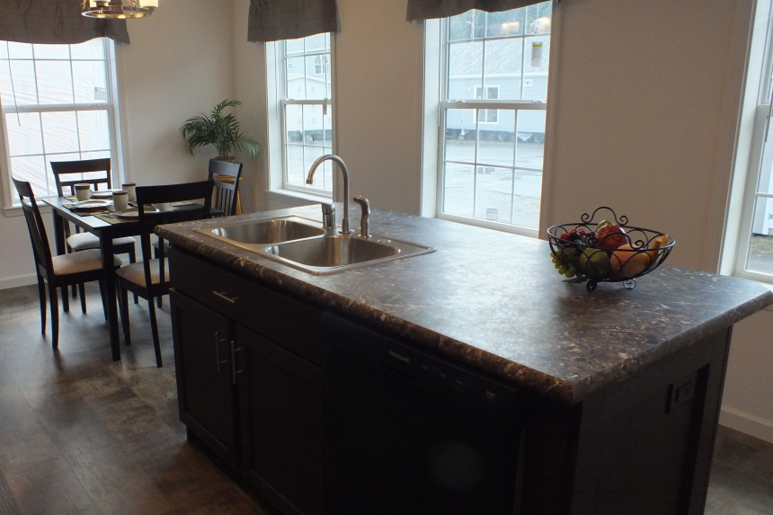 Photo Of Double Wide Home 303 Stock Model Kitchen Island With Dining Area In Background
